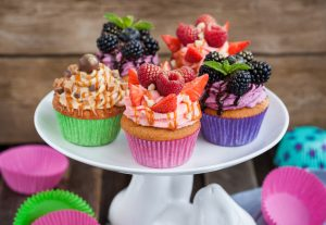 Set of different delicious cupcakes on funny cake-stand